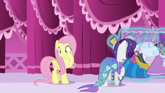 File:Rarity looks for another costume while Fluttershy rubs her cheek S5E21.png