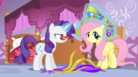 Rarity levitating headdress pieces onto Fluttershy S4E19