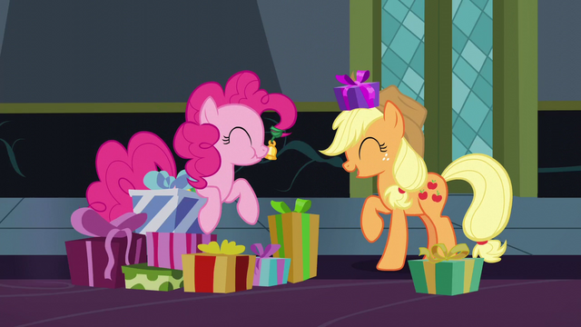 File:Applejack with a gift; Pinkie eating a cupcake S6E8.png