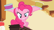 "Pinkie Pie ""assaulting"" Spike with cake S2E10.png"