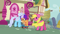 Scootaloo going past Shoeshine and Cherry Berry S3E6