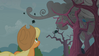 Applejack looking at dark clouds S2E12