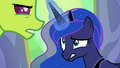 Princess Luna struggles with Thorax's medal S7E1.png