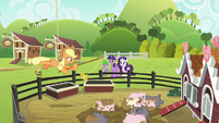 Spike, Twilight, and Rarity see AJ hanging from a rope S6E10