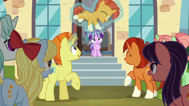 File:Sunburst's family and friends happy for him S6E1.png