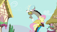 Fluttershy and Discord hugging S4E26