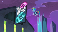 Rainbow in front of the neon sign S4E06