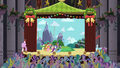 Audience cheers when Equestria flag is planted onstage S2E11.png