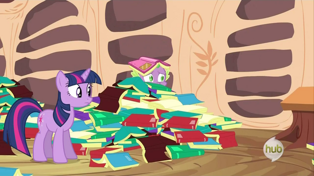 File:Spike peering from a pile of books S2E21.png