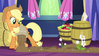 AJ pouring fertilizer in castle while flowers grow S5E03