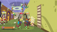 Discord hangs decorative rug on the wall S7E12