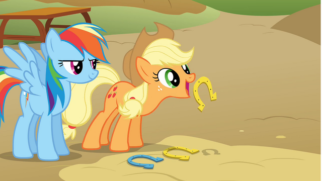 File:Applejack tossing a horseshoe S1E13.png