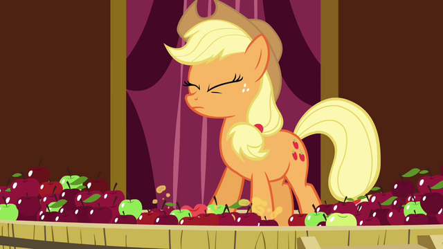 File:Applejack crushing the apples with her hoof S3E05.png