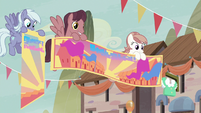 Our Town Pegasi holding festival banners S6E25