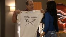 Jay shows Gloria the shirt he made for the family to support Manny-0