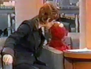File:Reba McEntire kiss Elmo.jpg