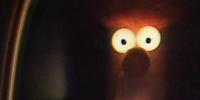 Beaker's glowing eyes