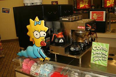 Maggie makes a break for the caffeine.