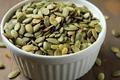 Bowl of pumpkin seeds.png