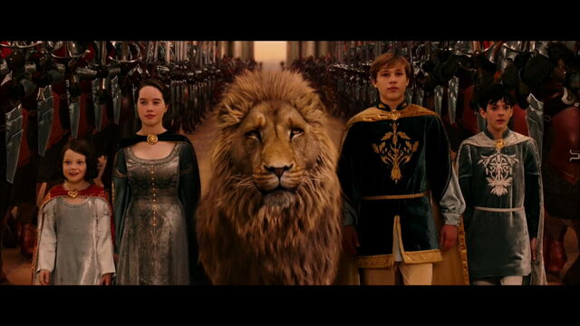 File:The-Pevensies-and-Aslan-anna-popplewell-1299415-1280-720.jpg