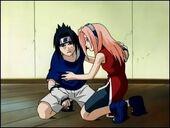 Sakura helps an injuried Sasuke