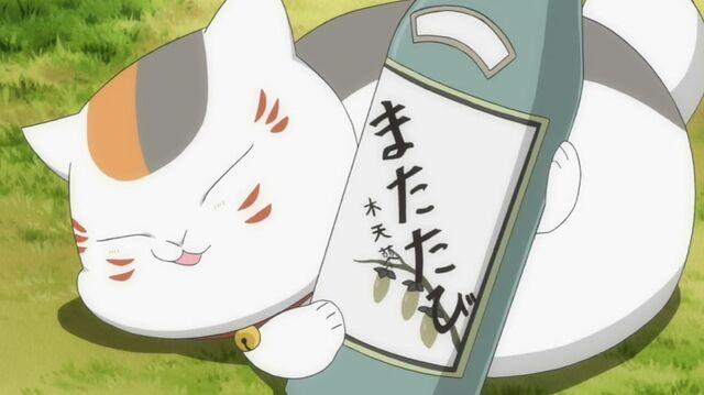 File:Madara with sake bottle.jpg