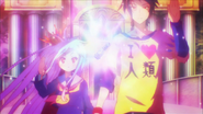 Sora and Shiro hold their hands up as they receive king piece