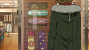 Yukine in front of a skate shop