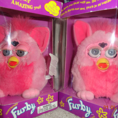 2 Pink Flamingo Furbies.