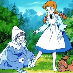 The Good Witch of the North helps Dorothy try on the Silver Shoes.