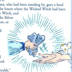 The Good Witch gives Dorothy the Silver Shoes.