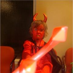 As a devil.