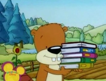 File:PB&J Otter - Munchy with a Stack of Books.jpg