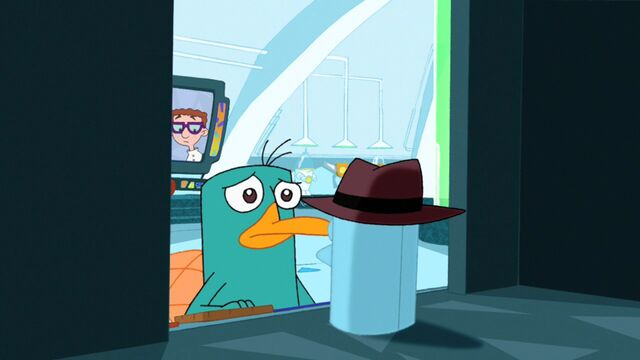 File:Agent P putting away his fedora.jpg