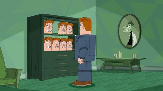 File:Norm with a closet filled with Norm heads.jpg