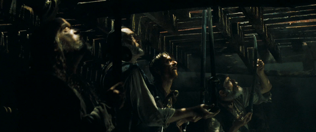 Bestand:Gibbs and crew handing weapons.png