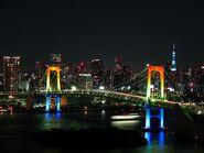 800px-Rainbow colored Rainbow Bridge at night