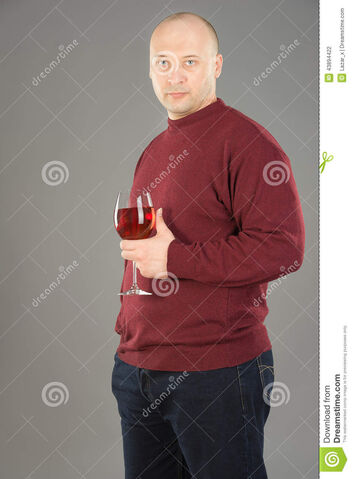 File:Rose-wine-cool-time-years-old-man-holding-wineglass-man-wearing-red-sweater-dark-blue-jeans-43894422.jpg
