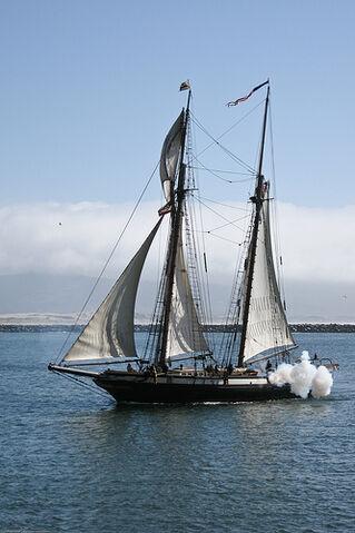 File:The sailing ship Lynx, firing cannons, enters Morro Bay 02 April 2009..jpg