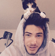 Cody Christian with a cat on his head