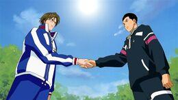 Tachibana shakes hands with Tezuka