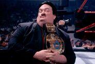 Paul bearer with wwf belt
