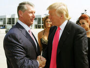 Donal Trump shaking the hand of long-time friend Vince McMahon