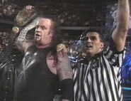 9817 - over the edge referee shane mcmahon smoking skull belt undertaker wwf