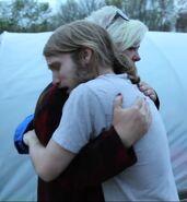 Anita hugging Jesse.
