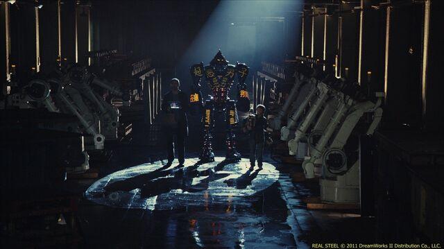 File:Charlie (hugh jackman) and his son, max (dakota goyo) enter former wrb robot noisy boy in an underground match.jpg