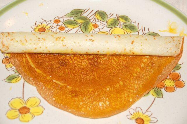 File:Roly-Poly Pancake Mango Jam filling being rolled up..jpg
