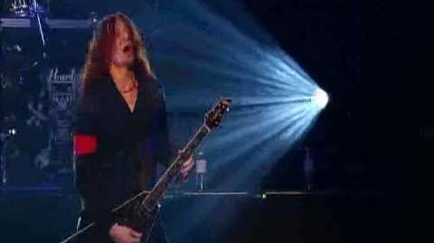 Michael Amott showcasing his distinctive playing style with Arch Enemy in Tokyo