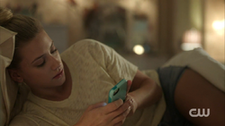 Season 1 Episode 2 A Touch of Evil Betty in bed and on her phone