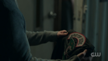 Season 1 Episode 13 The Sweet Hereafter Jughead holding Southside Serpent jacket 1
